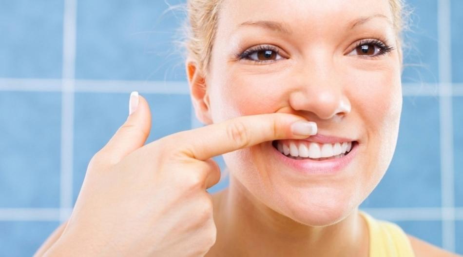 Как укрепить зубы, если они начали шататься?