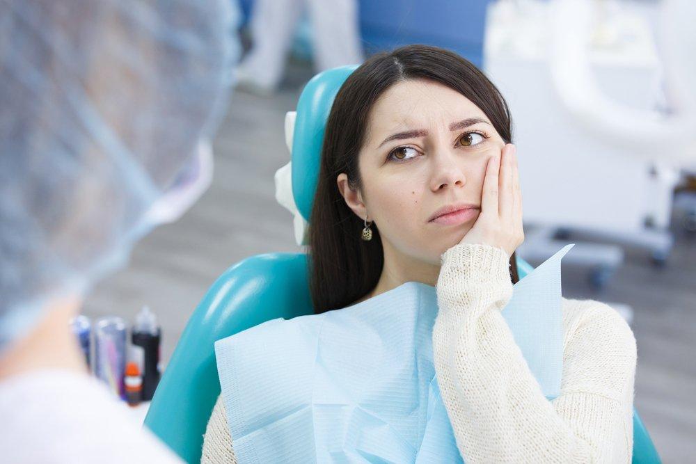 Болит зуб после лечения: симптомы и причины.